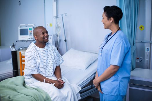 Nurse interacting with patient during visit