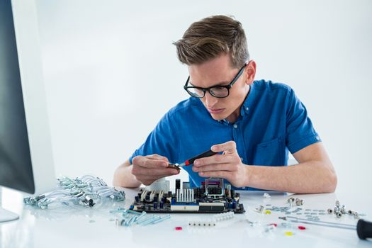 Computer technician repairing motherboard