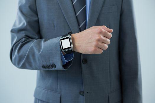 Businessman showing his smartwatch