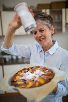 Senior woman preparing sweet food