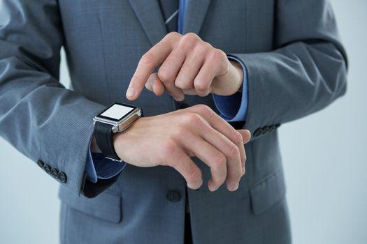 Businessman using his smart watch