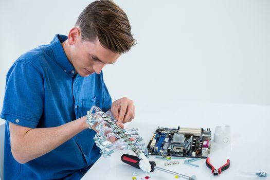 Computer engineer repairing computer motherboard