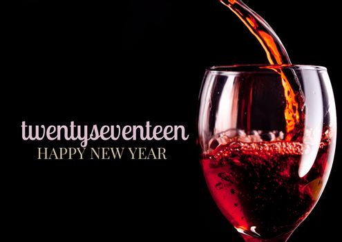 Close-up of 2017 happy new year wishes with red wine glass