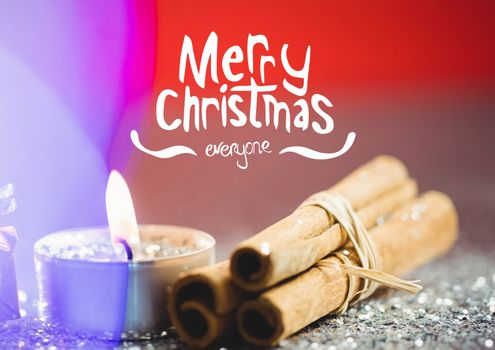 Happy christmas message against wax candle