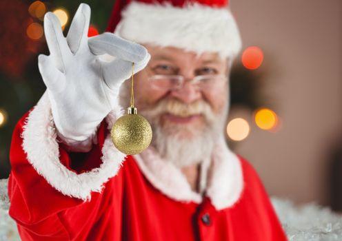 Santa holding christmas bauble
