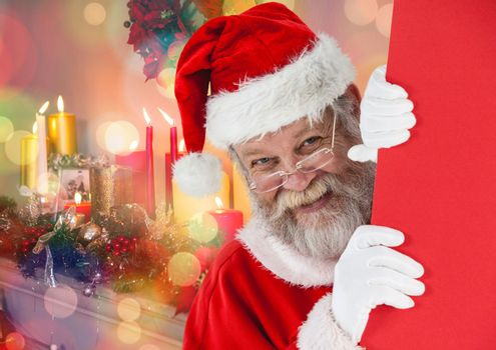 Santa peeking out from behind the wall