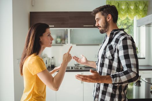 Couple having argument in kitchen