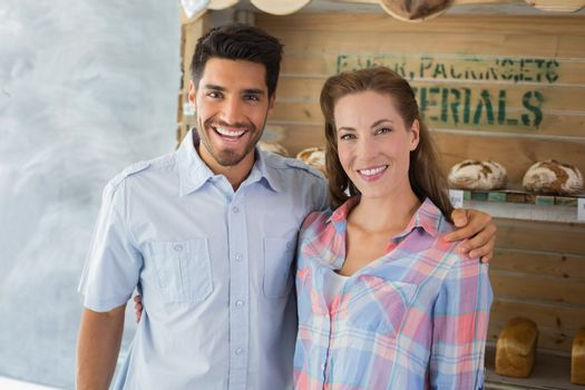 Couple with arm around at the bakery