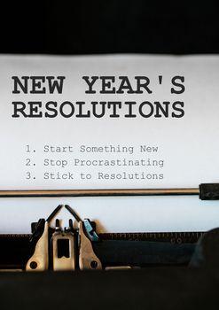 List of new year resolution goals typed on typewriter