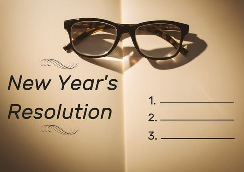 List of new year resolution goals against books and spectacles in background