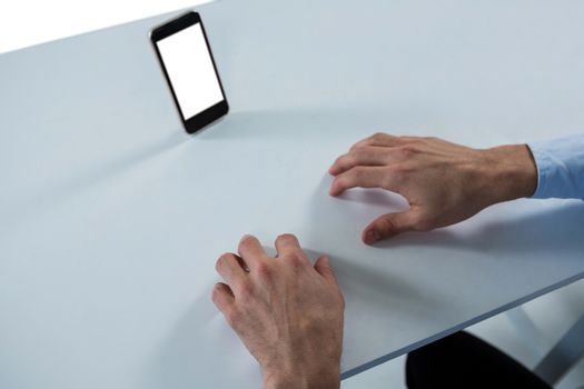Man pretending to type on invisible keypad
