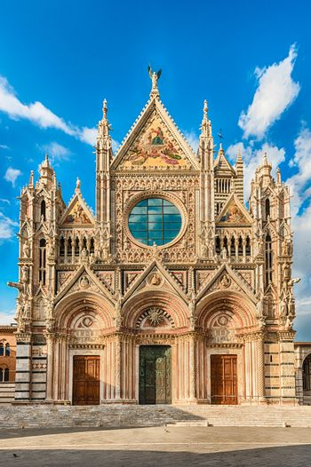 View of the facade of the gothic Cathedral of Siena, Tuscany, Italy. Completed in 1348, the church is dedicated to the Assumption of Mary and it is one of the most visited sightseeing of Siena