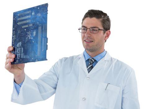 Computer engineer repairing motherboard