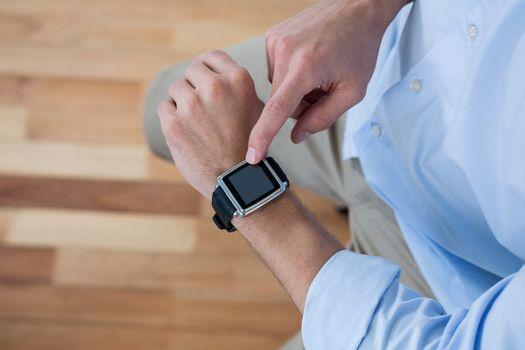 Man using his smart watch