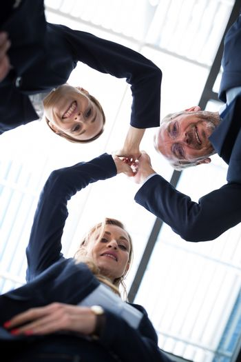 Happy businesspeople sharing high five