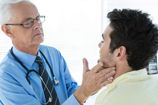Doctor examining patient jaw