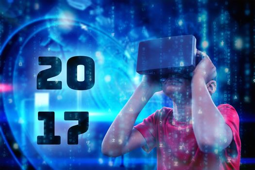 Composite image of boy with virtual reality simulator
