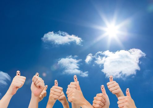 Thumbs up against sky background