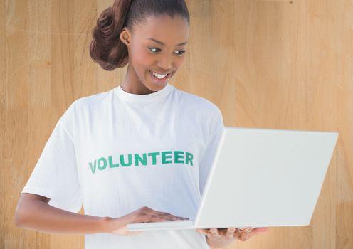Digital composite of Volunteer woman using laptop