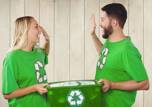 Volunteers holding recycling bin