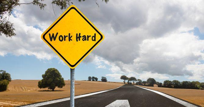 Sign work hard near road