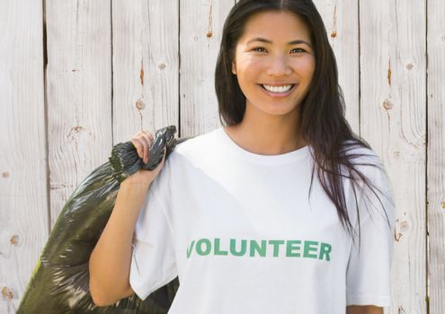 Volunteer woman with refuse sack