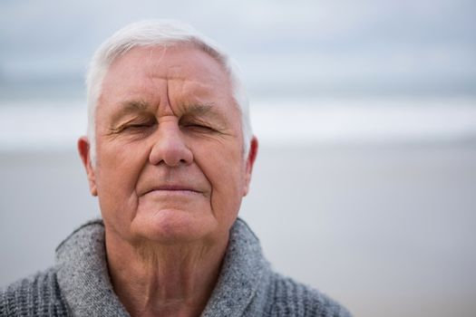 Senior man with eyes closed