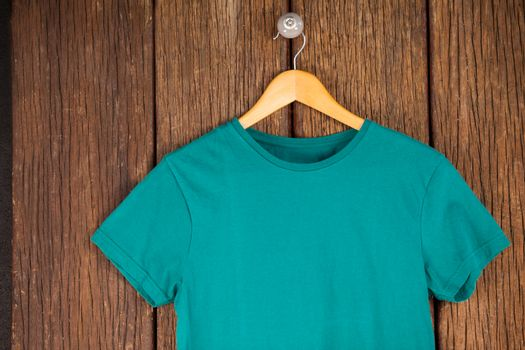 Turquoise t-shirt on hanger