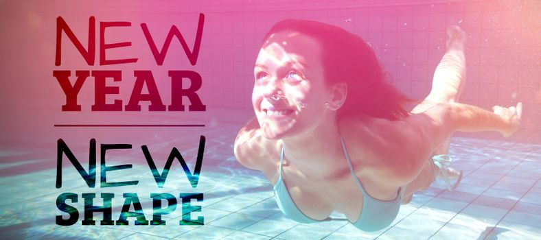 New year new shape against pretty brunette smiling and swimming underwater
