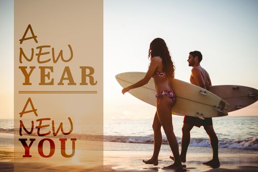 New year new you against side view of couple holding surfboards while walking