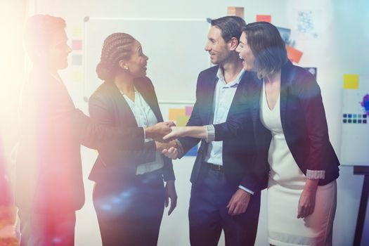 Group of happy businesspeople shaking hands