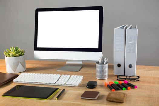 Desktop pc with office stationery
