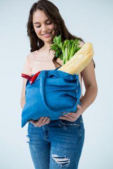 Beautiful woman carrying grocery bag