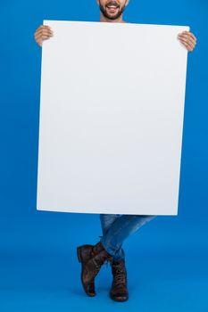 Man holding a blank placard