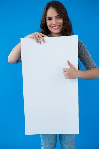 Woman holding a blank placard