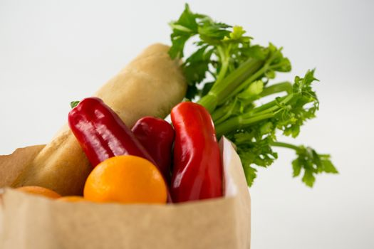 Fruits and vegetables in brown grocery bag