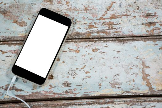 Smartphone on wooden plank