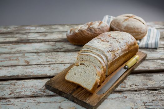 Bread loaf with knife