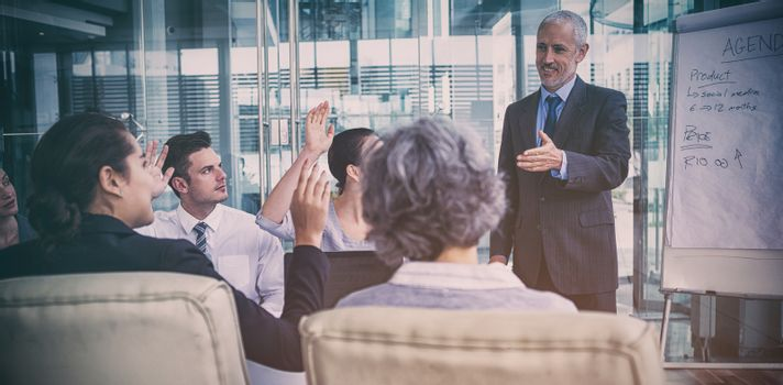 Businessman interacting with coworkers