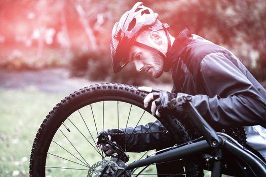Cyclist fixing bike