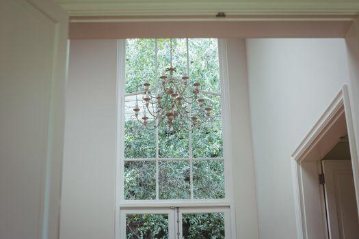 Chandelier hanging against window