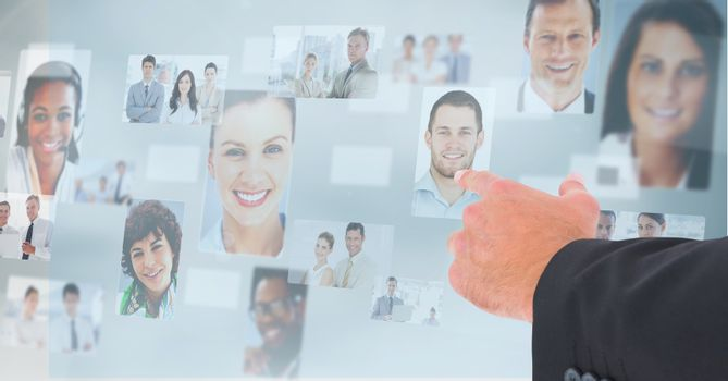 Hand touching profile pictures of business executives