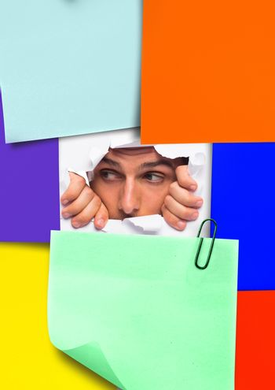 Man peeking through sticky notes
