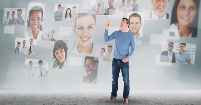 Man touching on profile pictures of business executives