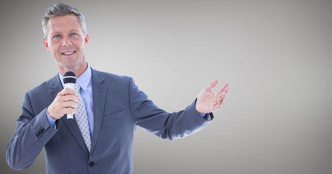 Businessman speaking on microphone