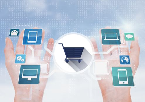 Digital composite of hand with shopping cart on digital screen