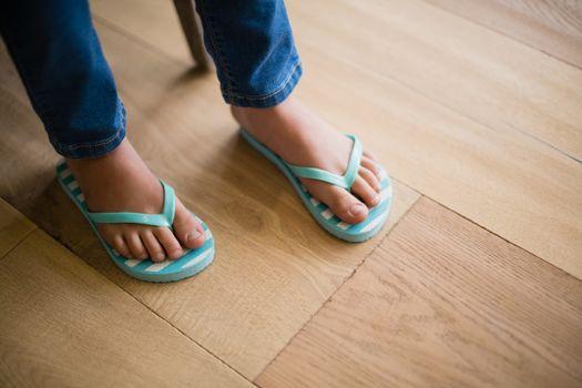 Girl in slipper at home