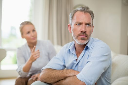Couple having an argument in living room