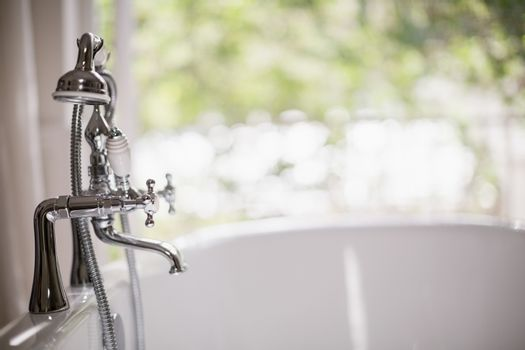 Close-up of tap with bathtub