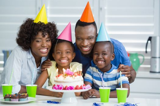 Portrait of happy family celebrating birthday party at home
